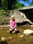 Amanda sitting in the creek
